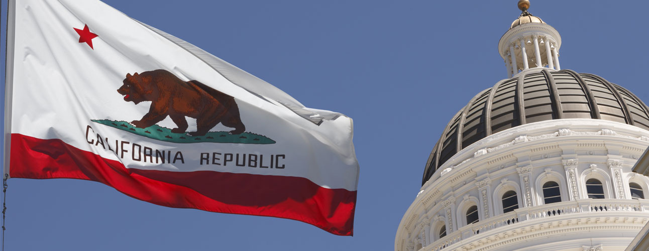 California flag waving in front of the State Capitol building in Sacramento