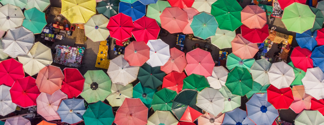 Collage of aerial view of umbrellas